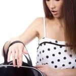 Model checking her bag — Stock Photo #1358704