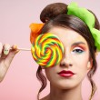 Beautiful model with lollipop — Stock Photo