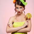 Beautiful model with lollipop — Stock Photo #1364928
