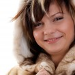 Girl in fur coat on white background — Stock Photo #1369476