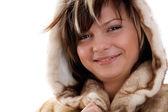 Fille en manteau de fourrure sur fond blanc — Photo