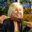 Stock Photo: Smiling girl with shashlik