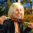 Smiling girl with shashlik — Stock Photo