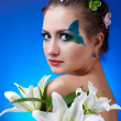 Girl with butterfly bodyart — Stock Photo