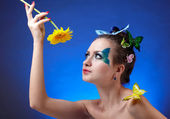 Model with butterfly bodyart — Stock Photo