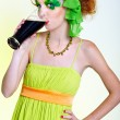 Red-haired girl drinking stout - Stock Photo