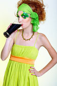 Red-haired girl drinking stout — Stock Photo