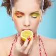 ������, ������: Beautiful girl tasting lemon