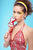 Beautiful girl with lollipop — Stock Photo