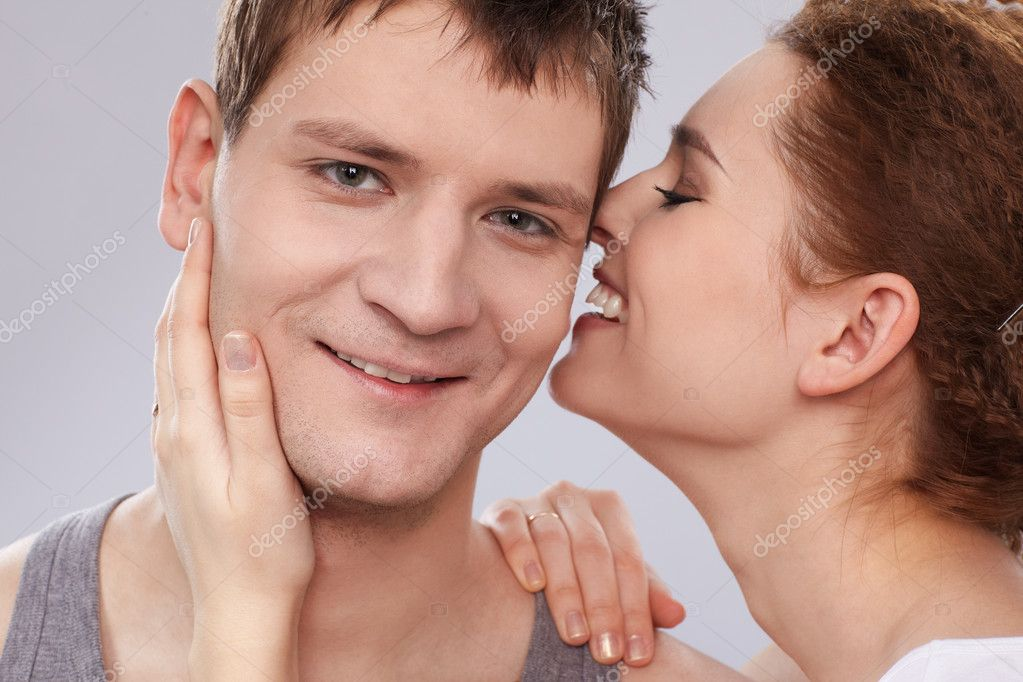 Portrait of young caucasian couple on gray — Stock Photo #2606991