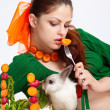 Girl and pygmy rabbit - Stock Photo