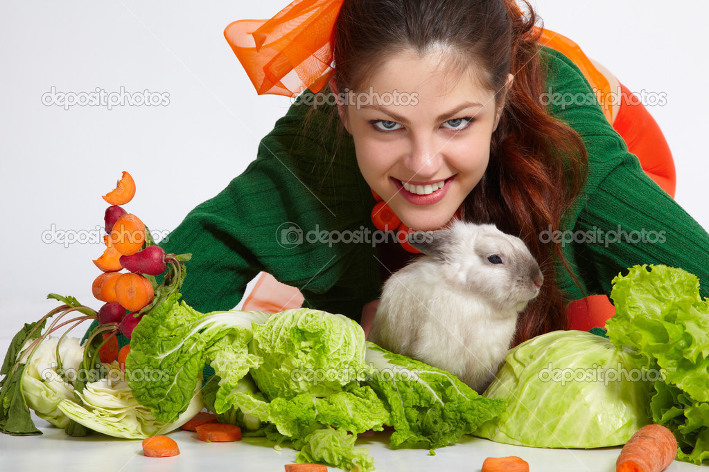 Happy girl with her lovely pet - pygmy rabbit — Stock Photo #2620703