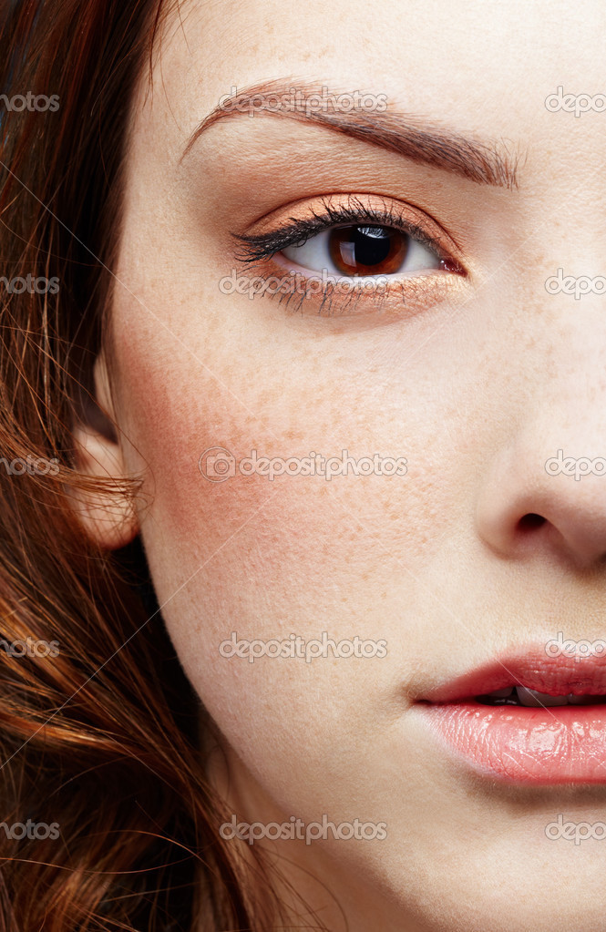 Half-face portrait of pale freckled girl  Stock Photo #2677101