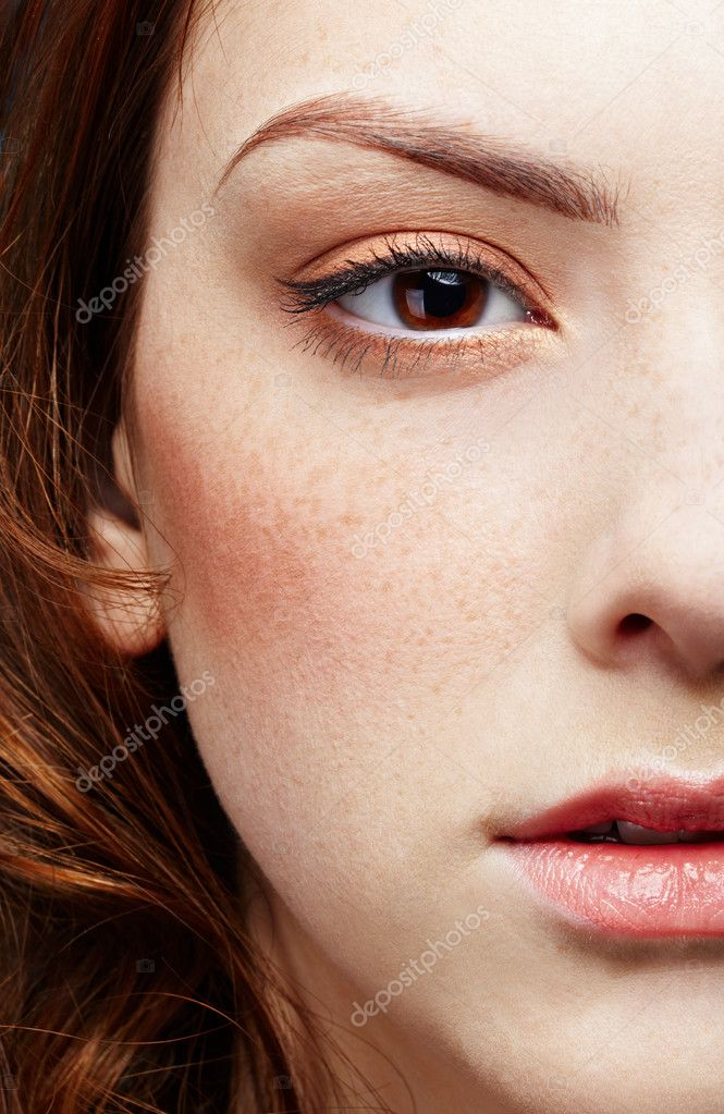 Half-face portrait of pale freckled girl — Stock Photo #2677101