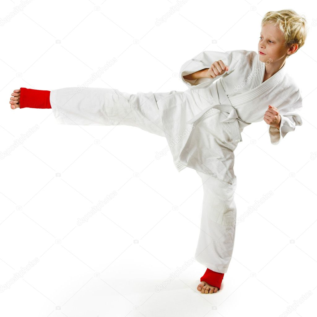 Karate boy exercising on white background — Stock Photo #1391472