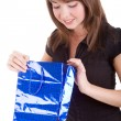 Girl with blue paper bag - Stock Photo