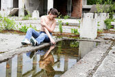 Girl playing with water — Stock Photo