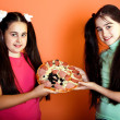 Royalty-Free Stock Photo: Two young girls with one pizza