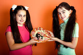 Two young girls with one pizza — Stok fotoğraf