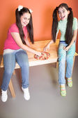 Two pretty girl with pizza on desk — Foto Stock