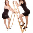 Girls with stepladder — Stock Photo