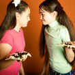 Royalty-Free Stock Photo: Opposite funny girls with pizza