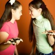 Opposite funny girls with pizza — Stock Photo