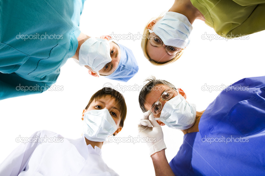 Young successful medical team on the white — Stock Photo #2058999