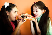Two pretty girls with pizza — Stock Photo
