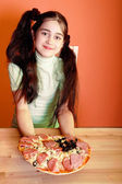 Young girl with pizza — Stok fotoğraf