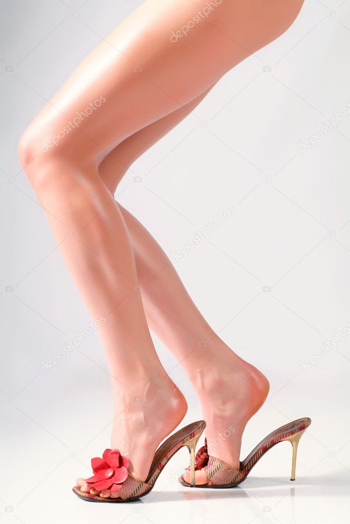 Female feet in sandals on the heels — Stok fotoğraf #1269877