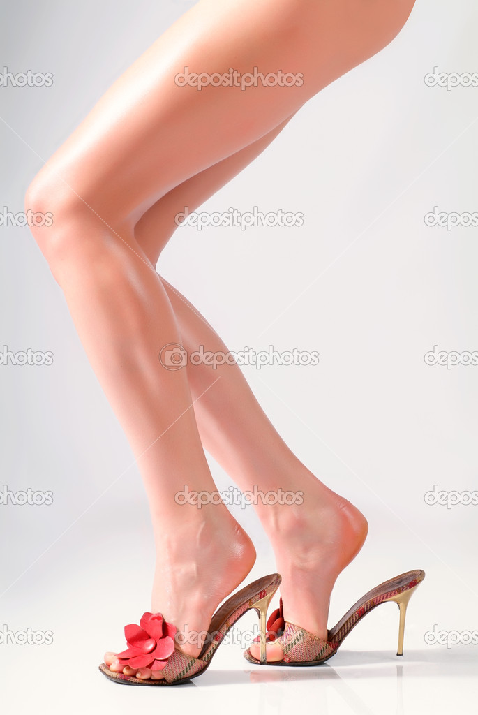 Female feet in sandals on the heels — ストック写真 #1269877