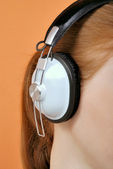 Woman in headphones close-up — Stock Photo