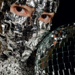 Stock Photo: Womwith foil and disco ball