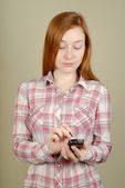 Woman writes in the PDA — Stock Photo