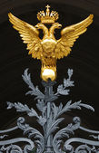 Gilt double-headed an eagle — Stock Photo