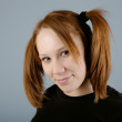 Young beautiful woman with pigtail — Stock Photo