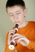 The boy playing the flute — Stock Photo