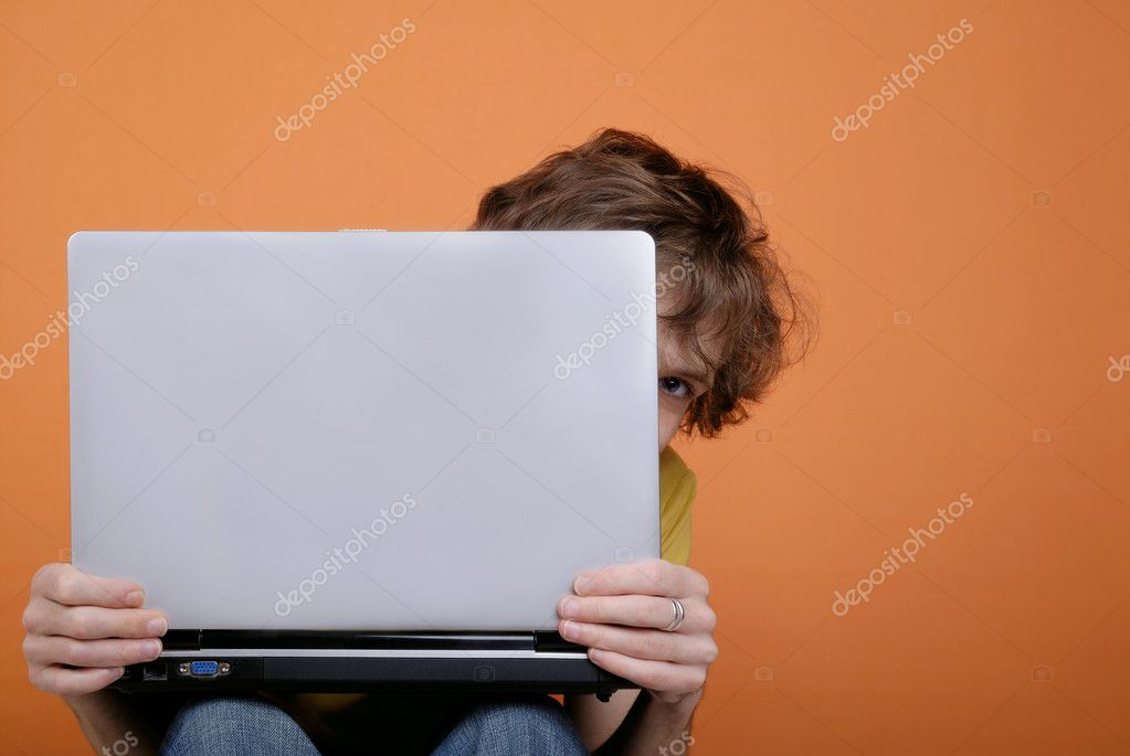 Hiding young man behind the laptop with copy space — Stock Photo #2082417