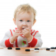 Child plays checkers on white — Stock Photo