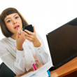 Brunette at work - Stock Photo