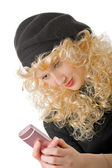 Blonde with a cellular telephone — Stockfoto
