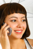 Brunette talking on a cellular phone — Stock Photo