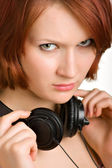 Caucasian girl with headphones — Stockfoto