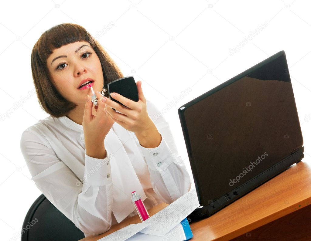 Brunette at work. A girl dyes lips.  Stock Photo #1213677