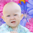 Kid on the flowers background — Stock Photo #1227374