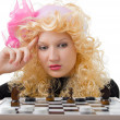 Stock Photo: Glamor blonde plays chess