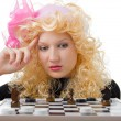 Glamor blonde plays chess — Stock Photo #1229840