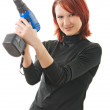 Girl with a drill in the hands — Stock Photo