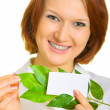 Smiling girl with a business card — Stock Photo